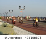 People walk and ride bicycles on the seaside promenade, resort Sochi, Russia, August 4, 2016 - stock photo