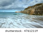Sea motion long exposure, Portreath pier, Cornwall UK. - stock photo