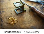 inspecting gold. gold nuggets... | Shutterstock . vector #476138299
