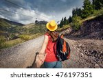 Tourist Woman With Backpack An...