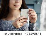 white brunette girl using... | Shutterstock . vector #476290645