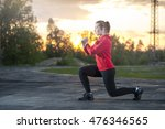 fit woman in sportswear doing... | Shutterstock . vector #476346565
