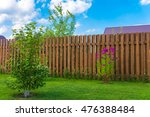 wooden fence in a country house | Shutterstock . vector #476388484