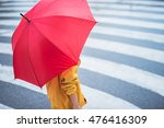 Woman With Umbrella Crossing...
