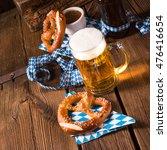 oktoberfest pretzel and beer   Shutterstock . vector #476416654