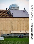 """Small photo of Wakefield, PA - June 24. 2010: Called a """"barn raising"""", Amish farmers construct a barn in a day in Lancaster County."""