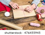 Woman Hands Wrapping Book For...