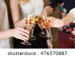 hands holding the glasses of... | Shutterstock . vector #476570887
