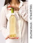 woman holding a white wine... | Shutterstock . vector #476639581