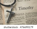 "Small photo of CHIANGMAI, THAILAND, August 31,2016. Reading The New International Version of the Holy Bible on the book of "" 1 timothy "" with the holy cross on table at home"
