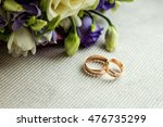 wedding rings lie on the table
