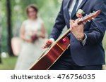 the groom plays the guitar for... | Shutterstock . vector #476756035