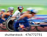 Small photo of finishing spurt wheelchair in motion at the stadium