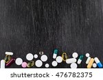 closeup of pills lying on table.... | Shutterstock . vector #476782375
