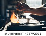 carefully bringing metal up to... | Shutterstock . vector #476792011