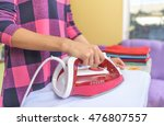 the woman to iron the clothes... | Shutterstock . vector #476807557