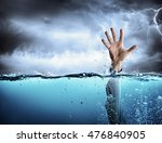 Small photo of Help Concept - Drowning And Failure - Man s Hand In Sea