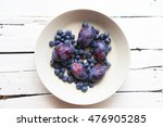 blueberry and plums on a plate ... | Shutterstock . vector #476905285