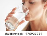 beautiful girl drinking water... | Shutterstock . vector #476933734