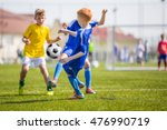 children's soccer match.... | Shutterstock . vector #476990719