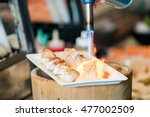 fire on sushi  | Shutterstock . vector #477002509