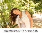 cute mature woman holds her... | Shutterstock . vector #477101455