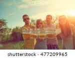 friends enjoying outdoors with... | Shutterstock . vector #477209965