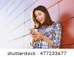 surprised young woman using... | Shutterstock . vector #477233677