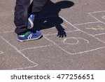 kid playing hopscotch on... | Shutterstock . vector #477256651