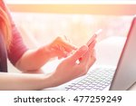 close up of woman hands using... | Shutterstock . vector #477259249