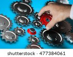 close up of a hand holding a... | Shutterstock . vector #477384061