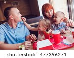 happy family eating fast food... | Shutterstock . vector #477396271