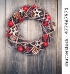 christmas wreath on wooden...   Shutterstock . vector #477467971