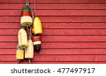 vintage lobster buoys hanging... | Shutterstock . vector #477497917