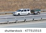 car with the trailer goes on... | Shutterstock . vector #477515515