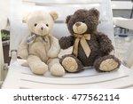 Two Cute Plush Bears Sitting O...