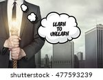 Small photo of Learn to unlearn text on speech bubble with businessman
