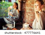 two happy young female friends... | Shutterstock . vector #477776641