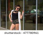 stylish woman with a headphones ... | Shutterstock . vector #477780961