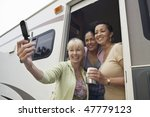 ladies in caravan using camera... | Shutterstock . vector #47779123