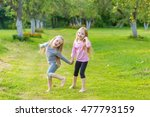 two cute girls playing in the... | Shutterstock . vector #477793159