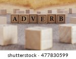 Small photo of ADVERB word written on building blocks concept