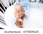 cute baby sitting in a white... | Shutterstock . vector #477839635