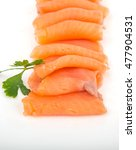 smoked salmon pieces in white... | Shutterstock . vector #477904531