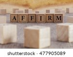 Small photo of AFFIRM word written on building blocks concept