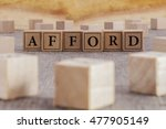 Small photo of AFFORD word written on building blocks concept