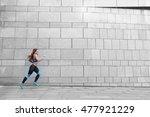 Runner Athlete Running On Gray...