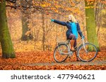 active woman riding bike... | Shutterstock . vector #477940621