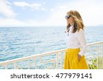 portrait of an lady standing on ... | Shutterstock . vector #477979141