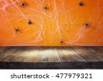 Stock photo halloween holiday concept empty rustic table in front of spider web background ready for product 477979321